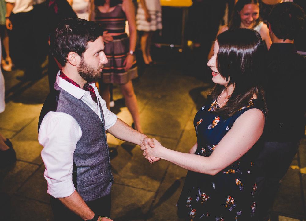 two wedding guests dancing- Lancashire wedding at Bashall barn