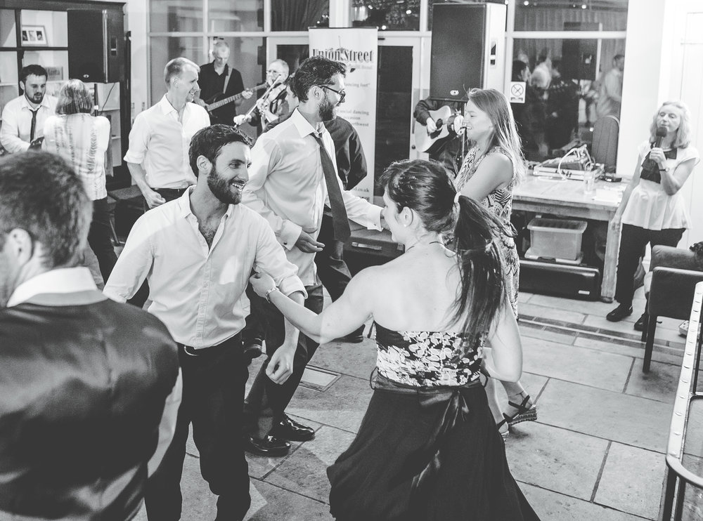 Black and white photograph of the wedding guest on the dance floor at Bashall barn