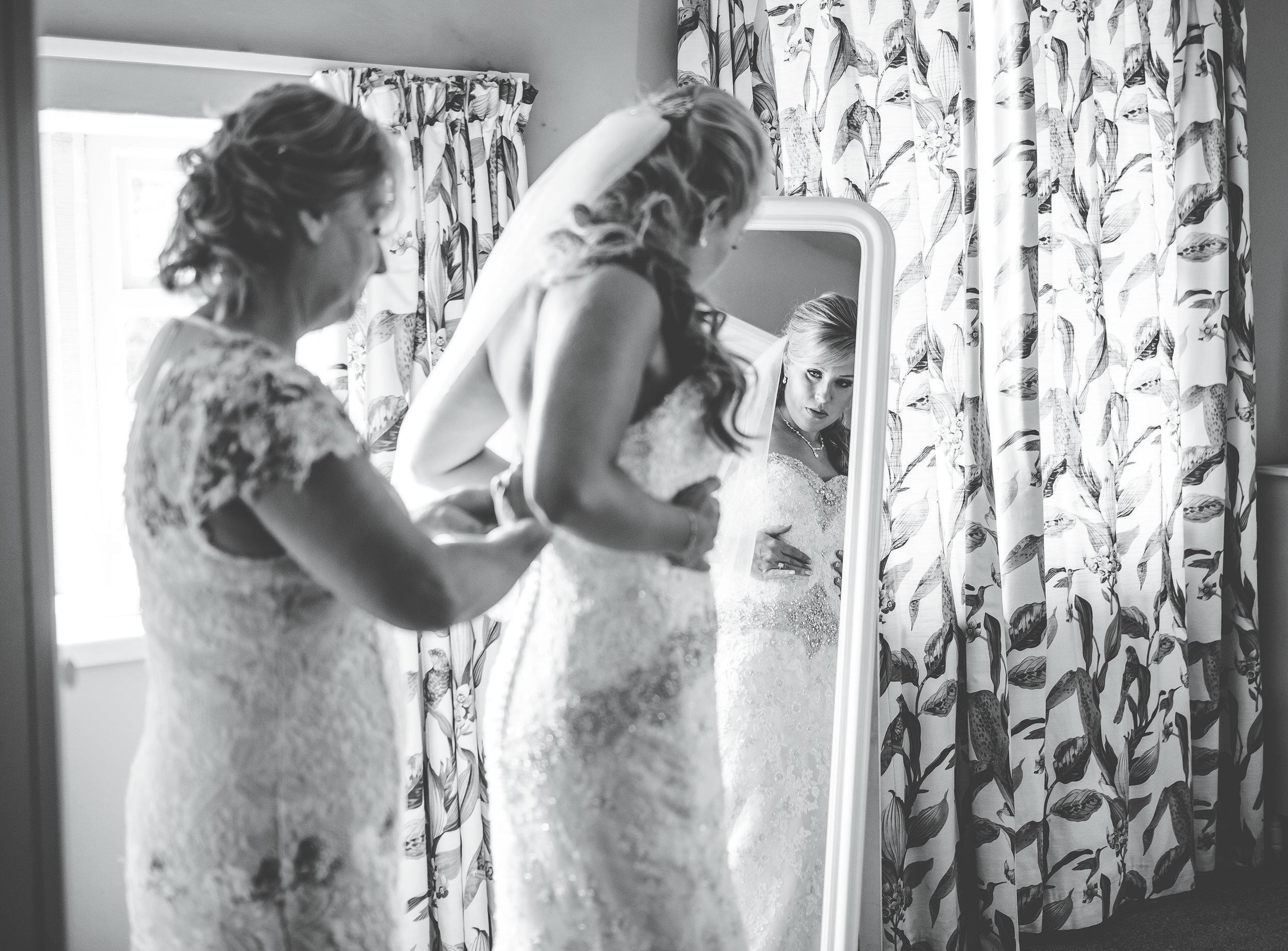 bride getting dressed - Browsholme Hall wedding