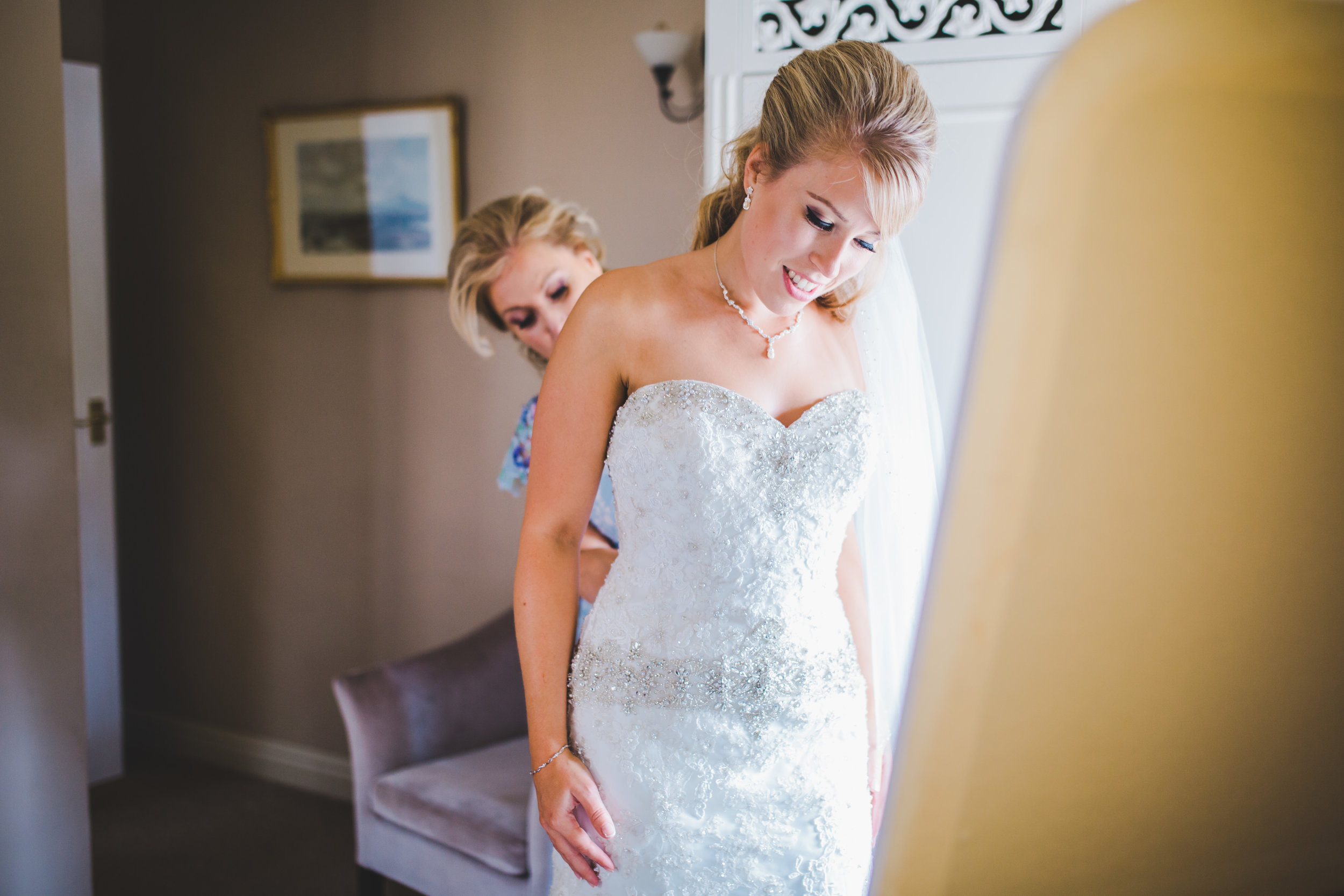 Bride getting into dress- Lancashire wedding photographer