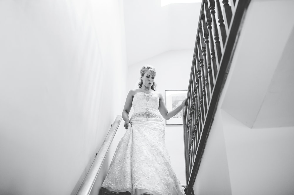 The bride walking down the stairs for her wedding at Browsholme Hall