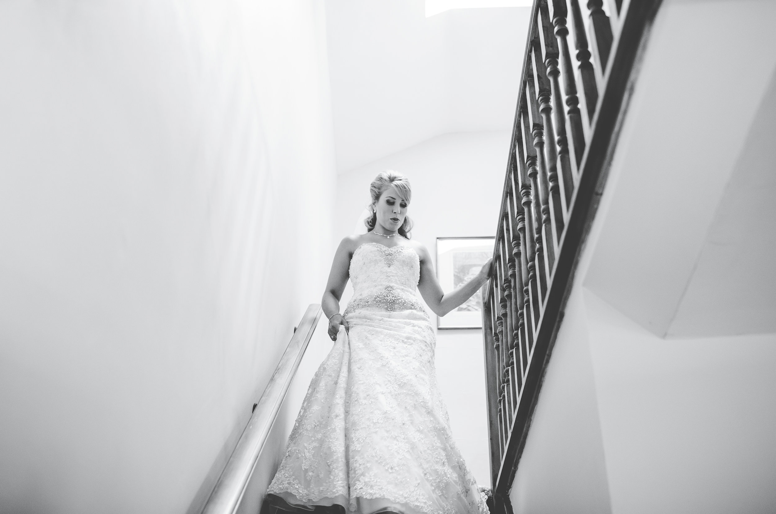 bride walks down the stairs at Browsholme Hall Lancashire