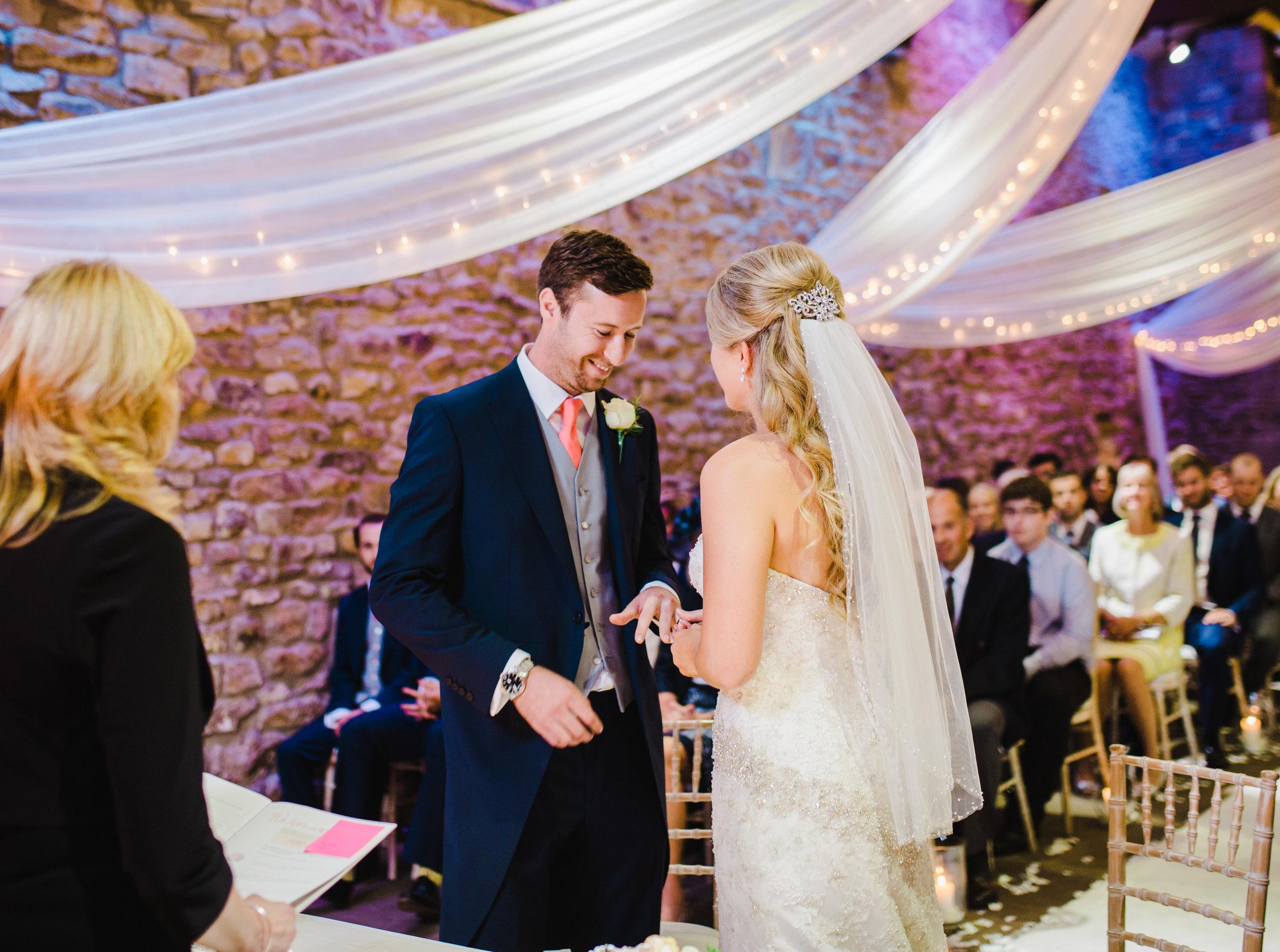 exchanging rings - Browsholme Hall wedding