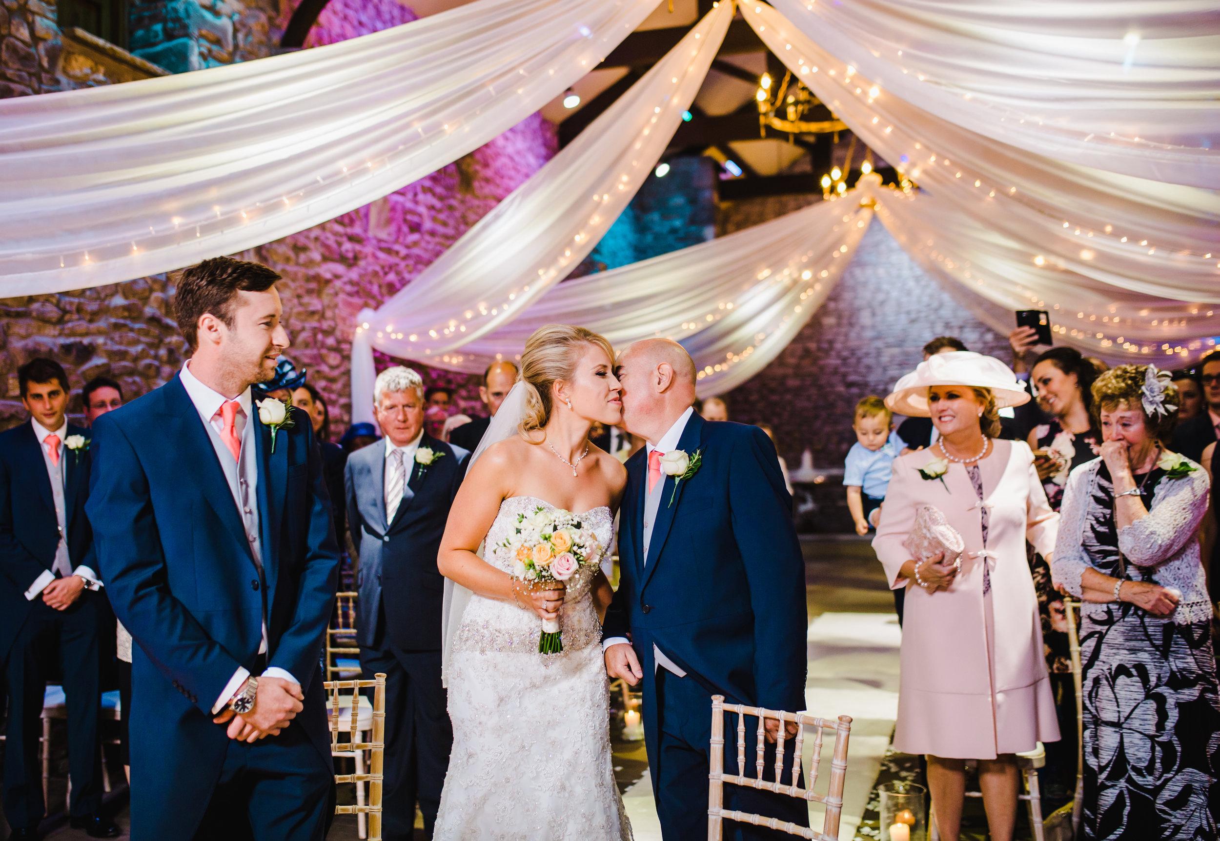 bride kisses dad