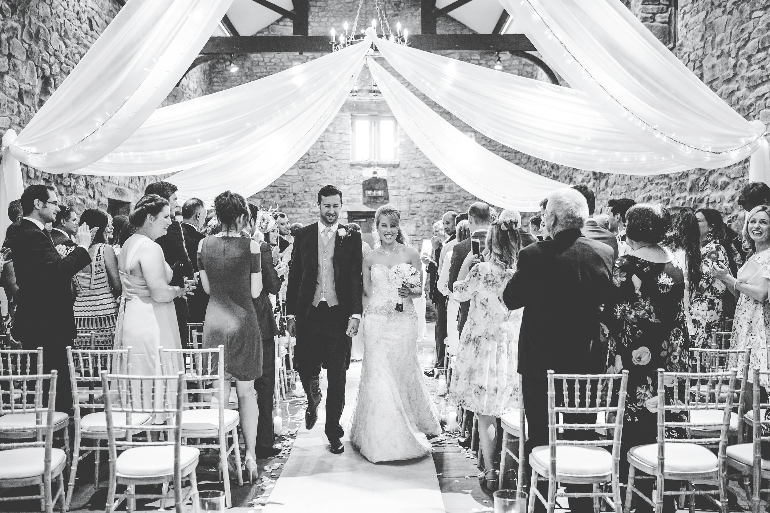newlyweds walking down the aisle at Browsholme Hall wedding