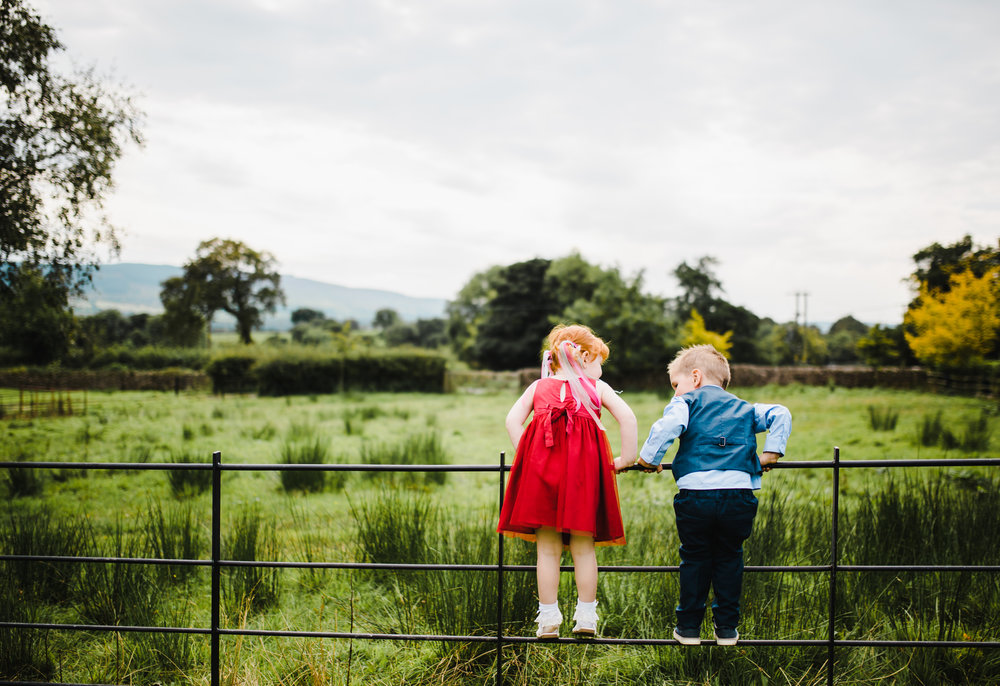 Two children stood on the fence at Browsholme Hall