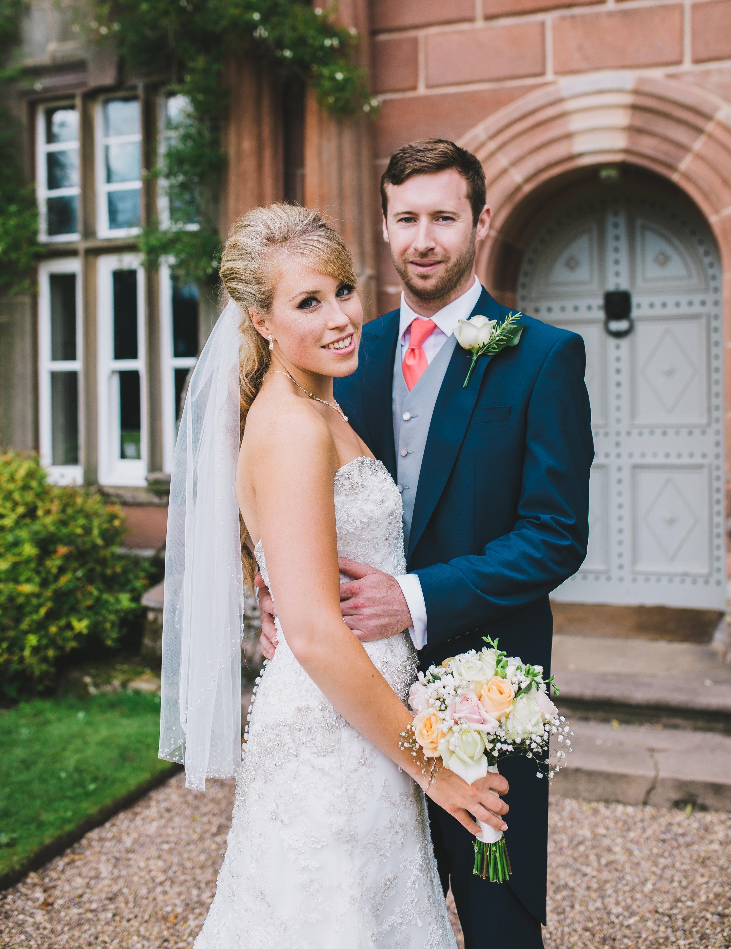 Browsholme Hall wedding - bride and groom outside the hall
