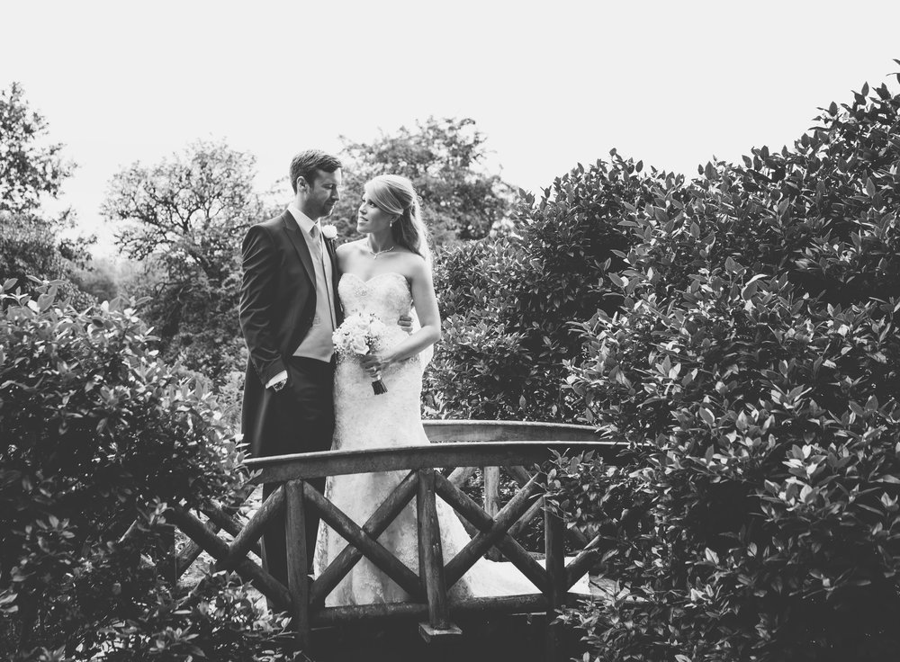 Black and white photo of the bride and groom on the bridge- Browsholme Hall