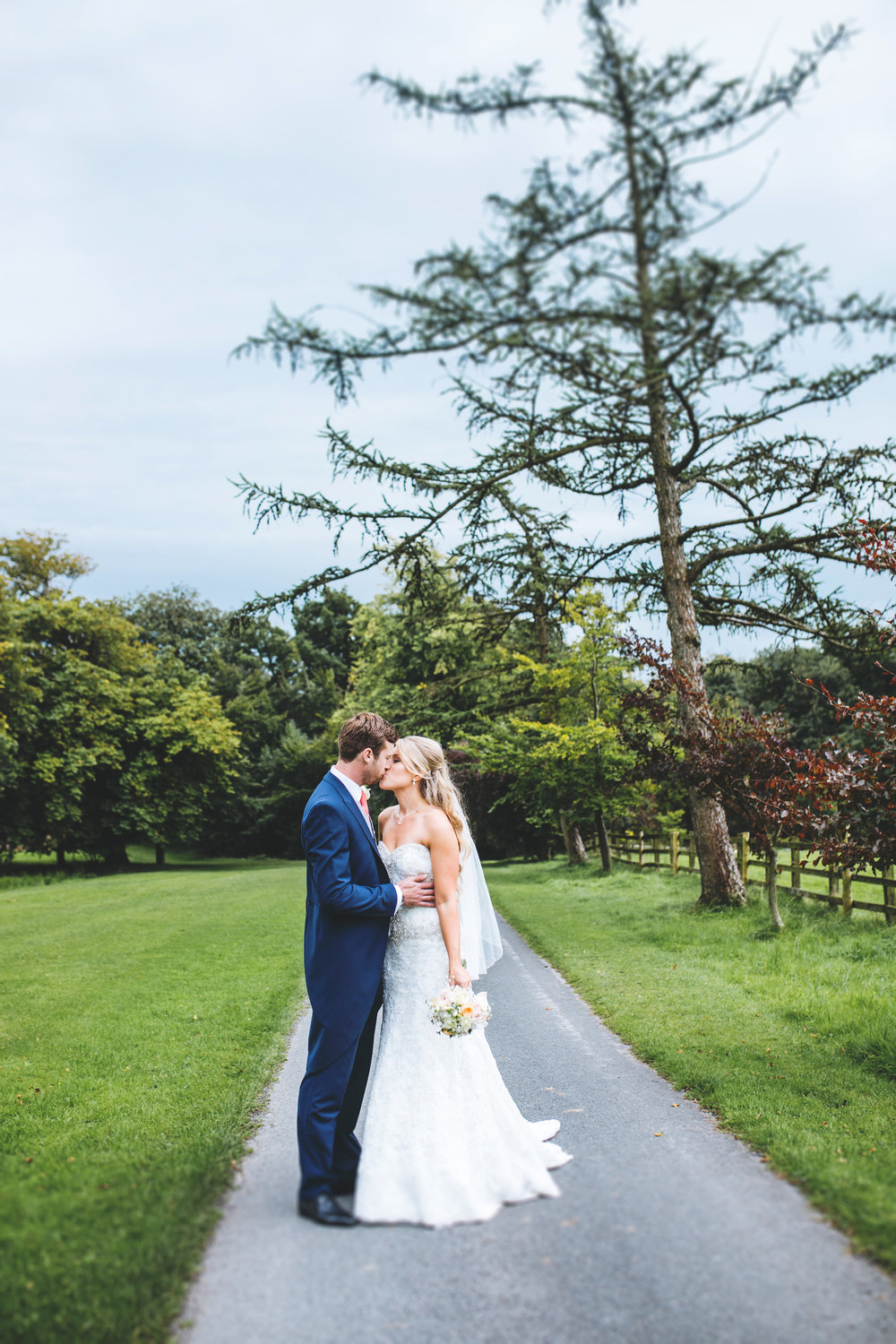 Portrait of the bride and groom kissing at Browsholme Hall- Creative wedding photography