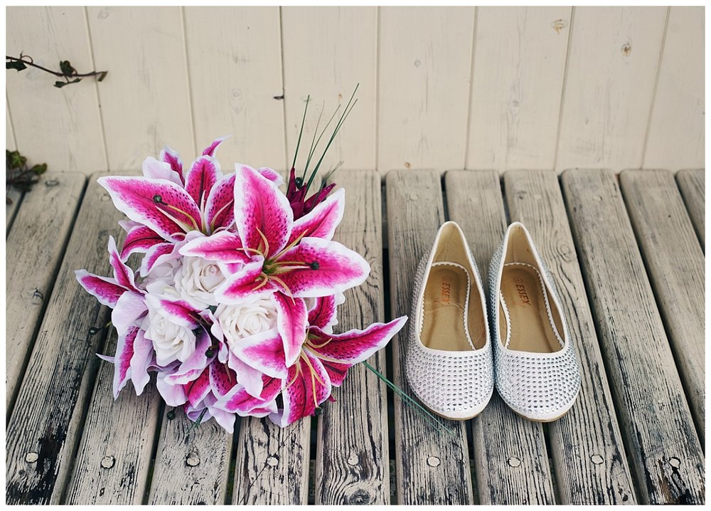 The brides shoes next to the flower bouquet- Cheshire wedding at Styal Lodge