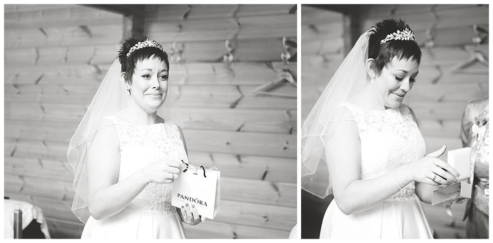 The blushing bride opening wedding gifts-styal lodge wedding in Cheshire