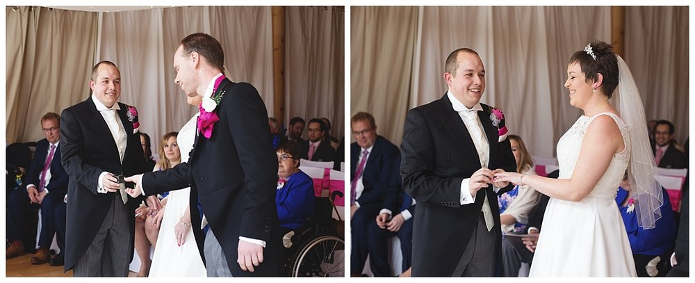 The best man passing the groom the rings during the wedding ceremony at tyal lodge wedding in Cheshire