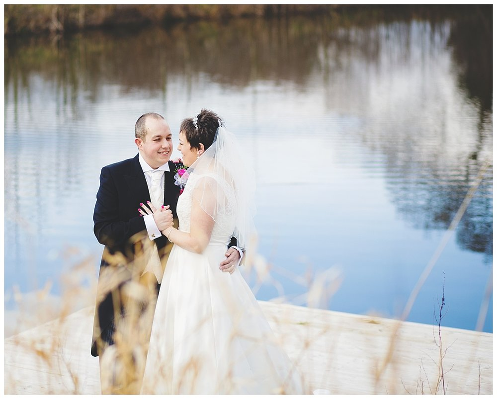 The bride and groom looking into one another eyes at styal lodge cheshire