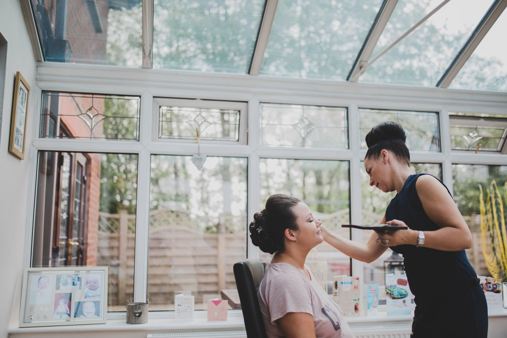 The bride getting her makeup done- relaxed wedding photography