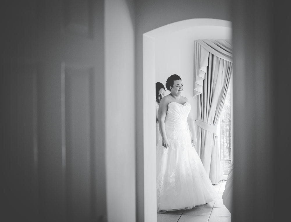 Black and white photograph of the bride in her wedding dress- documentary wedding photography, lancashire