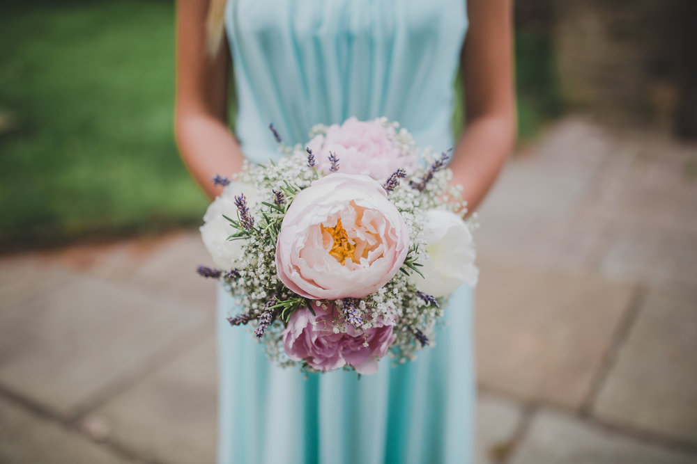 Bridesmaid holding colourful flower bouquet- Colourful wedding lancashire