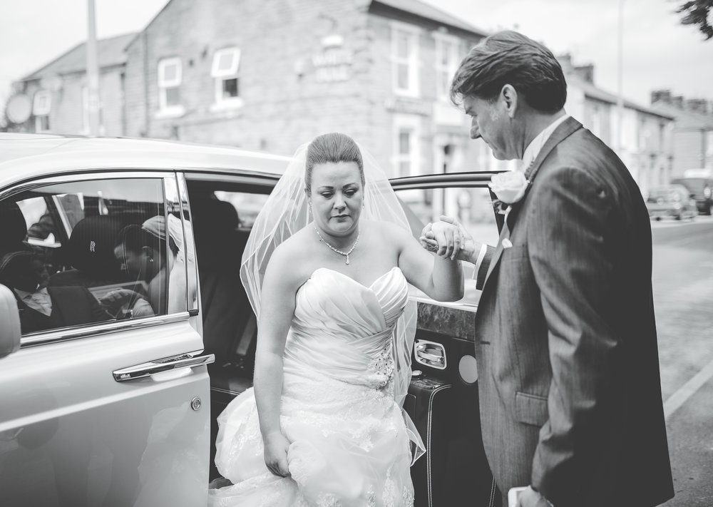 the bride getting out of her wedding car- Lancashire wedding photography