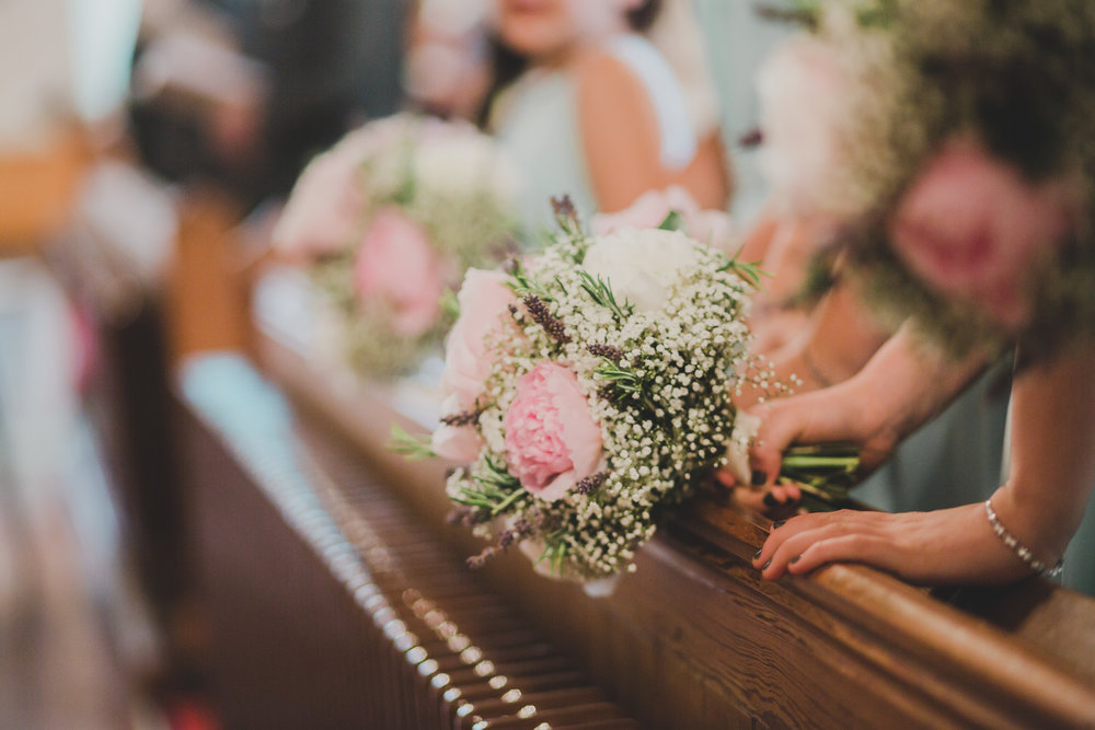 The flowers hung over the railing- Creative wedding photography