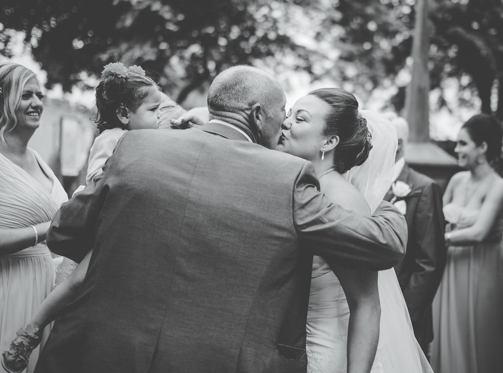 the bride kissing the cheek of one of the wedding guests- Lancashire wedding photography