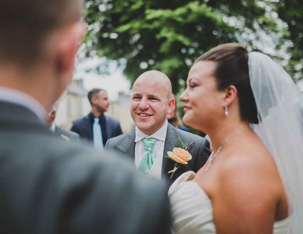 The bride and groom talking with guests- Lancashire relaxed wedding photography