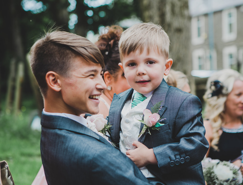 Two of the wedding guest smiling away- Modern wedding photography lancashire