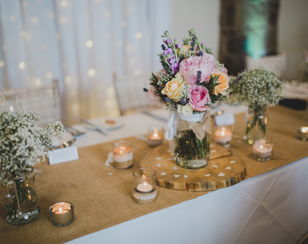 Flowers from the middle of the table arrangements- Lancashire wedding photography