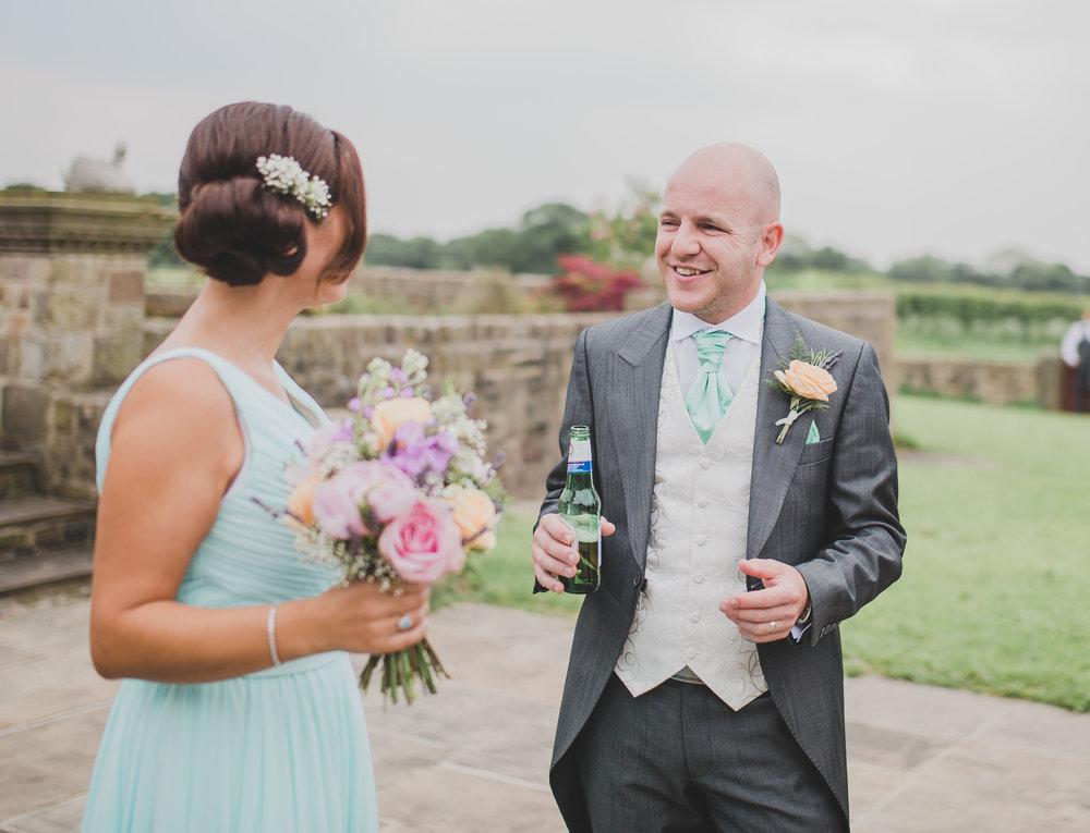 The groom and on elf the bridesmaids at Beeston Manor- Preston wedding photographer