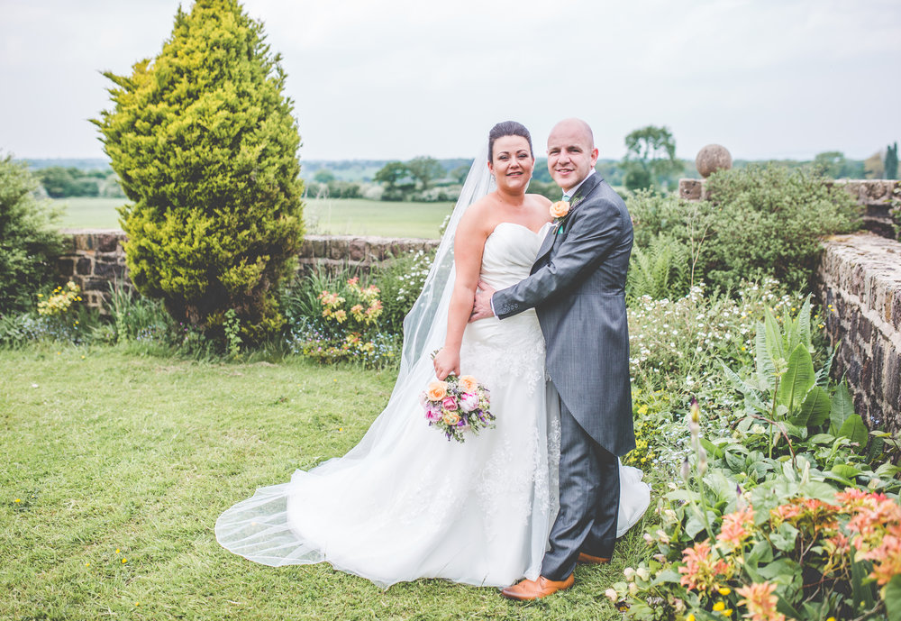 The bride and groom in the fields of Beeston Manor- Creative wedding photography