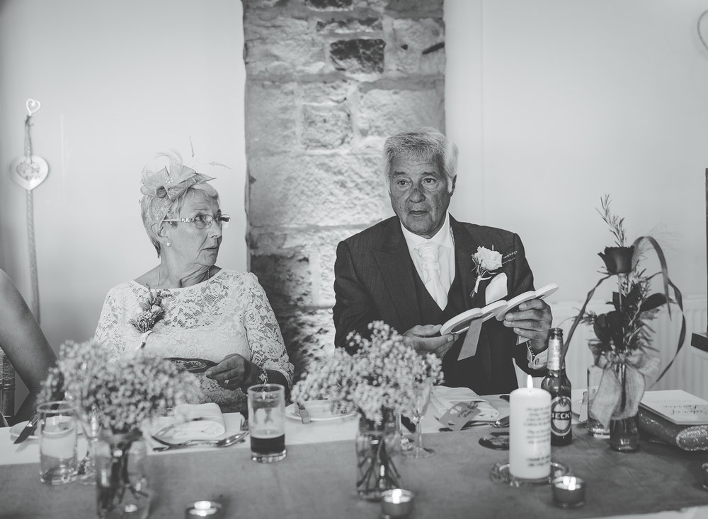 black and white photography of the wedding guests at the wedding meal- Beeston Manor, Preston