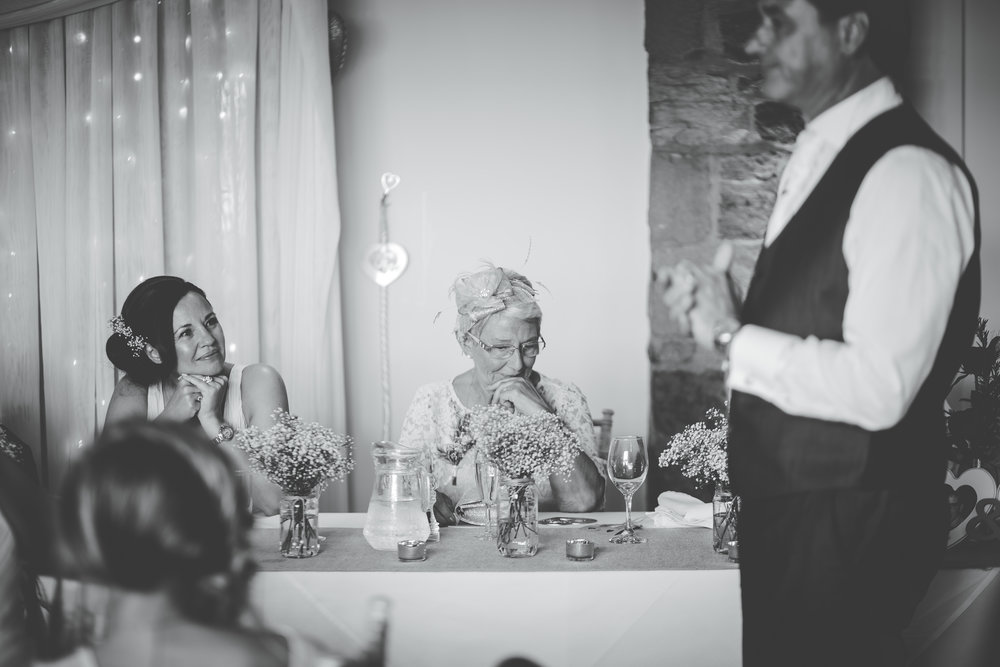 Black and white photograph of the wedding speeches at Beeston Manor