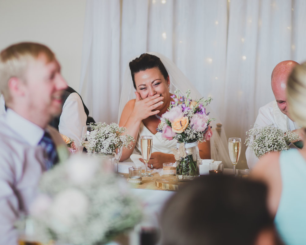 The bride laughing during the wedding speeches- Documentary lancashire wedding photography
