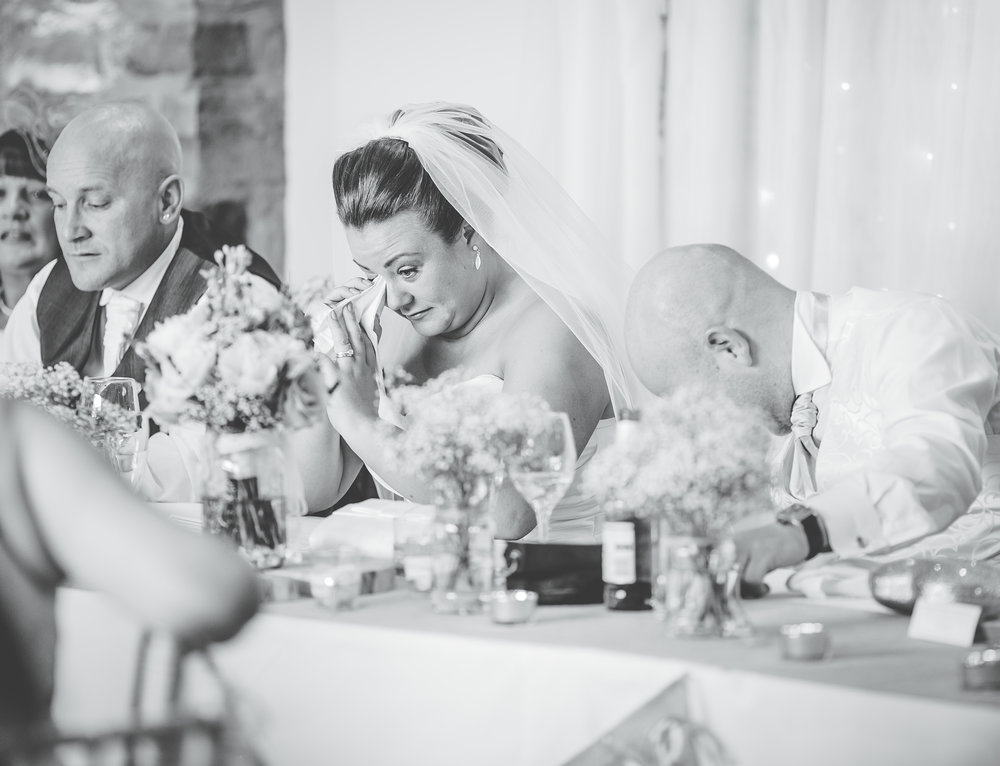Tears from the bride during the wedding speeches at Beeston Manor