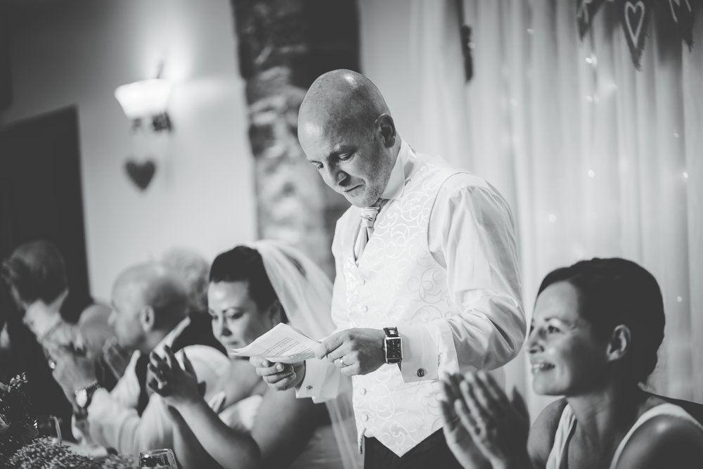 The groom giving his wedding speech, black and white photo- documentary wedding style photography
