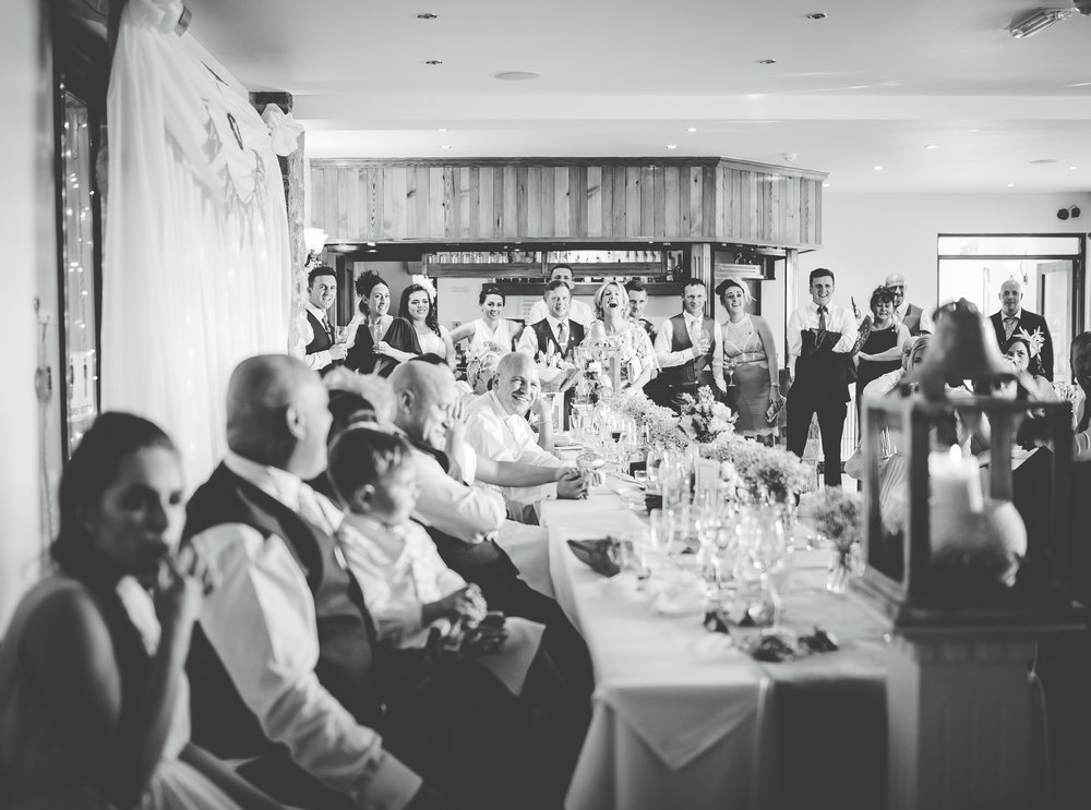 All of the wedding guests in the meal room at Beeston Manor