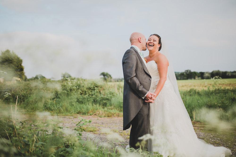 Creative photography of the bride and groom kissing outside of Beeston Manor, Preston- Lancashire wedding photographer