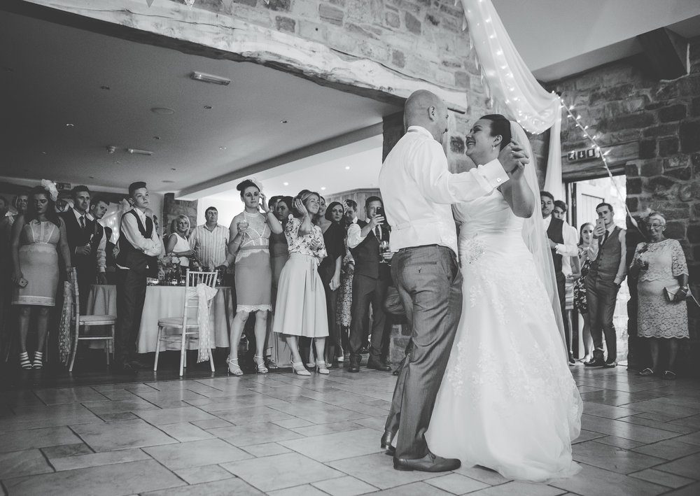 Black and white photograph o the bride and groom on the dance floor- Documentary wedding styled photography