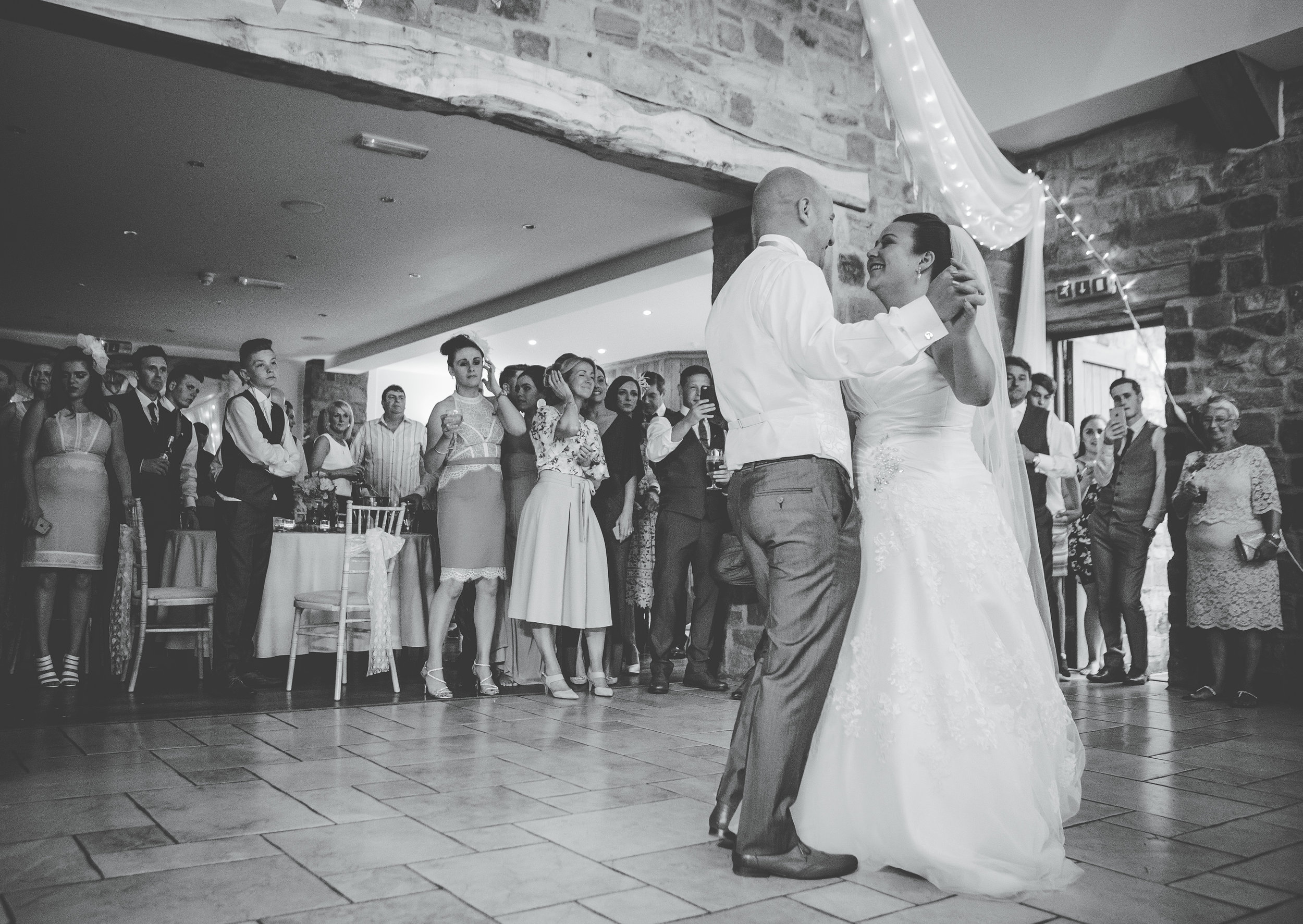 first dance surrounded by guests - Lancashire wedding photographer