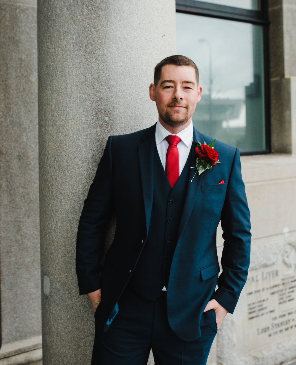 Portrait of the groom stood outside of Liver Building- Wedding photography in the North West