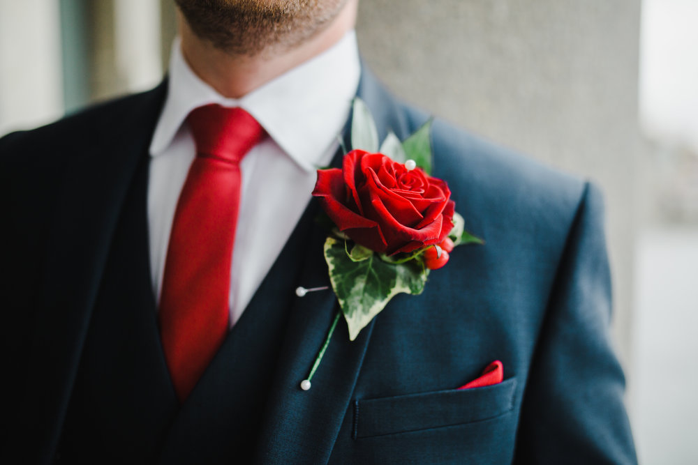 The detail of the grooms button hole flower and tie- Photographer in the North West