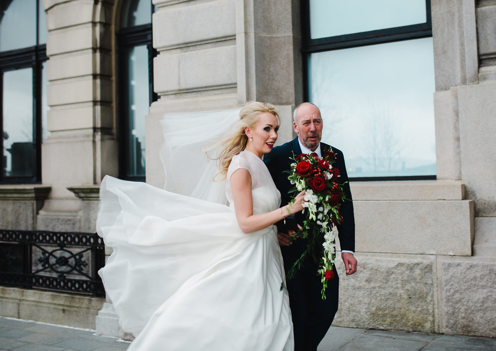 The bride walking to the liver buildings with her father- Northwest photographer in Liverpool