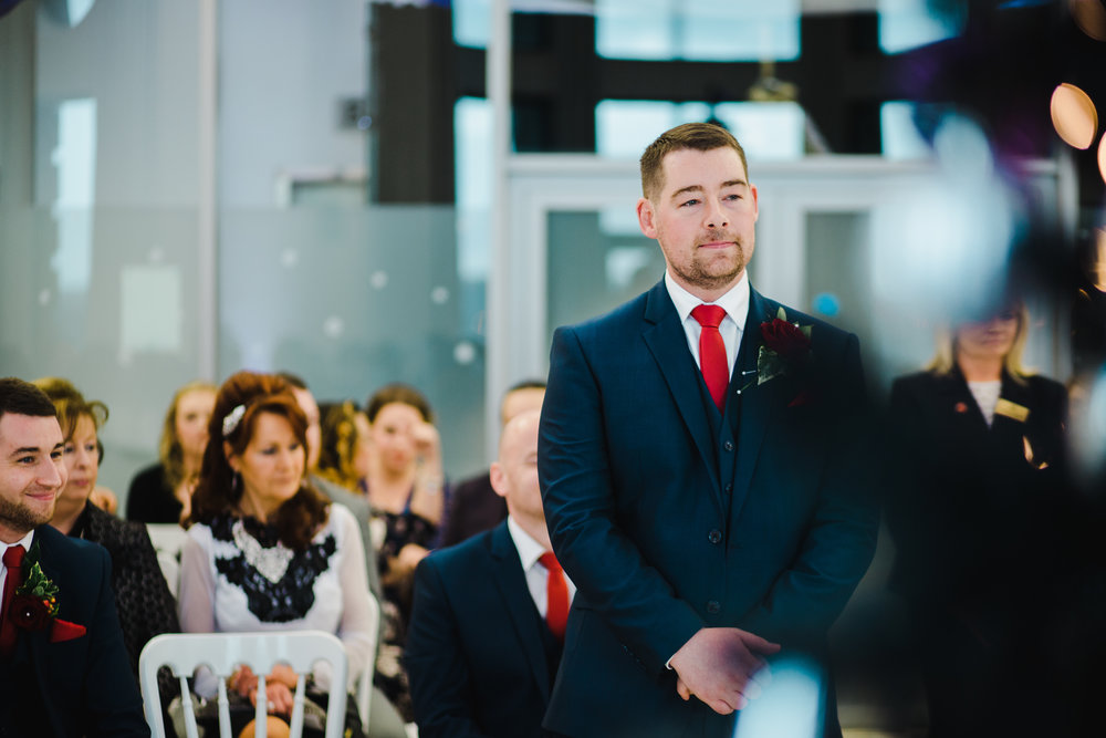 The groom stood at the alter- Documentary wedding photography in liverpool