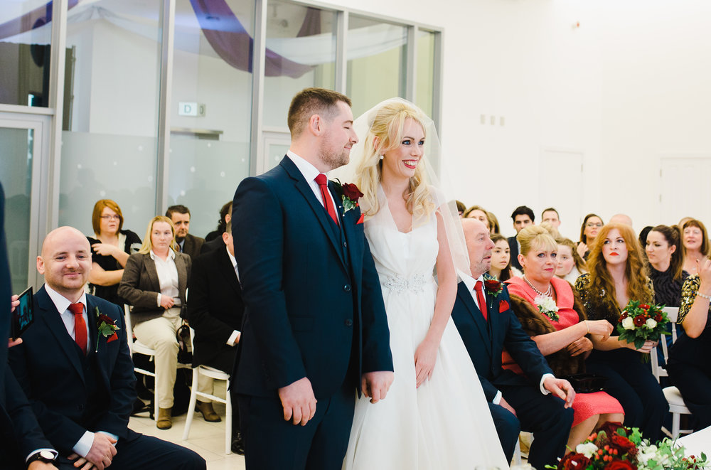 Bride and groom at the alter saying their vows- Christmas themed wedding at the liver building