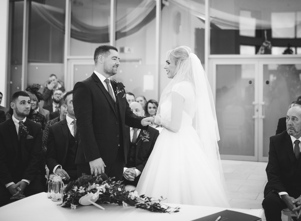 Bride and groom looking into one another eyes at the alter- Documentary wedding photography