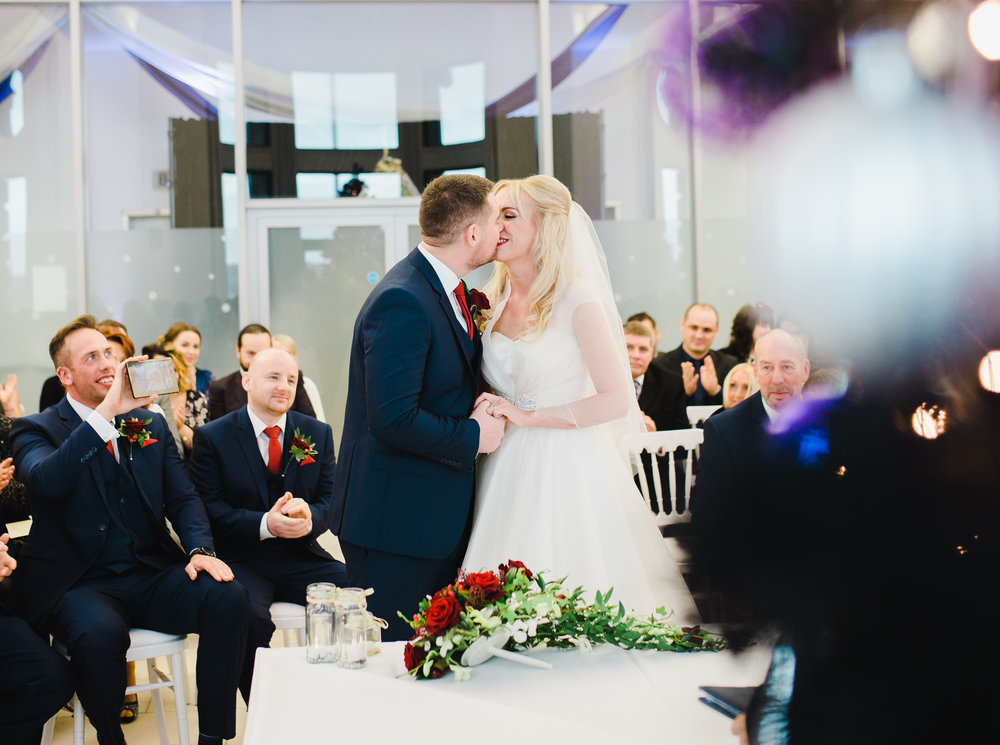 The bride and groom kissing at the later- Documentary wedding photography