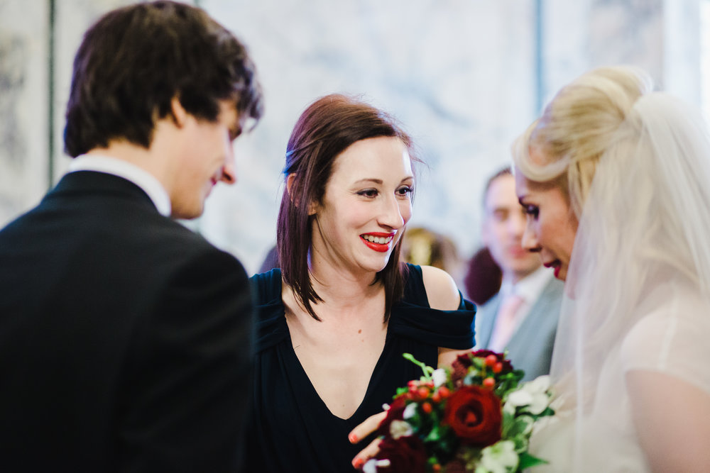 The bride and one of the wedding guests at the liver building