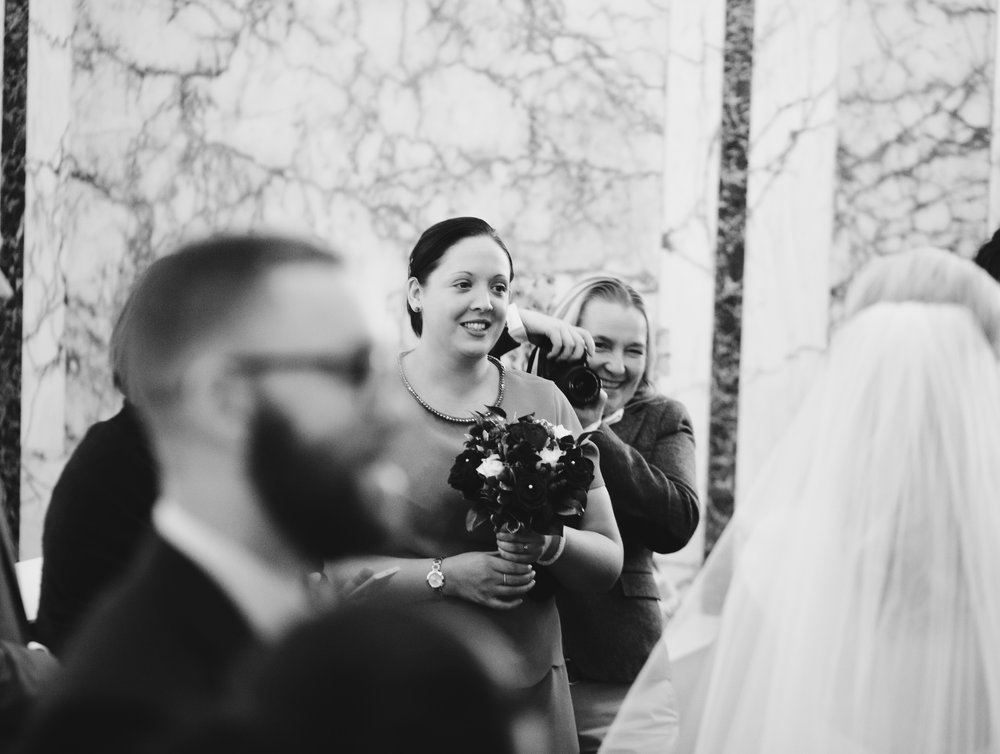 Black and white photography of the bride with wedding guests- Documentary wedding photography