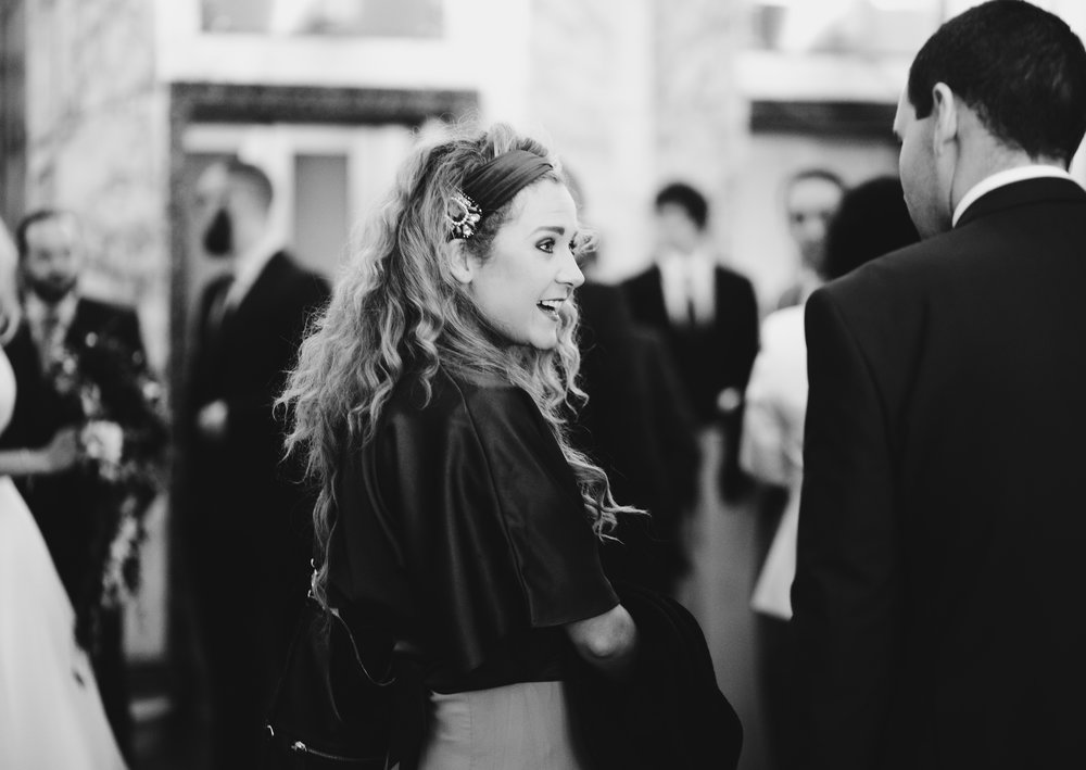 Smiles from one of the wedding guests at the liver building in liverpool- North west photographer