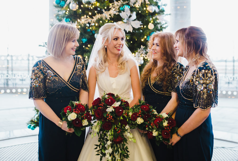 The bride surrounded by the bridesmaids at the Liver building in liverpool