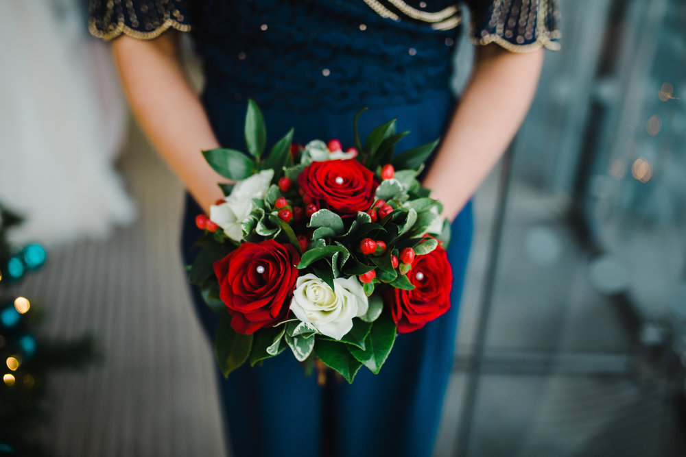 The bridesmaid with her flower bouquet- Winter wedding themed wedding in liverpool,north west