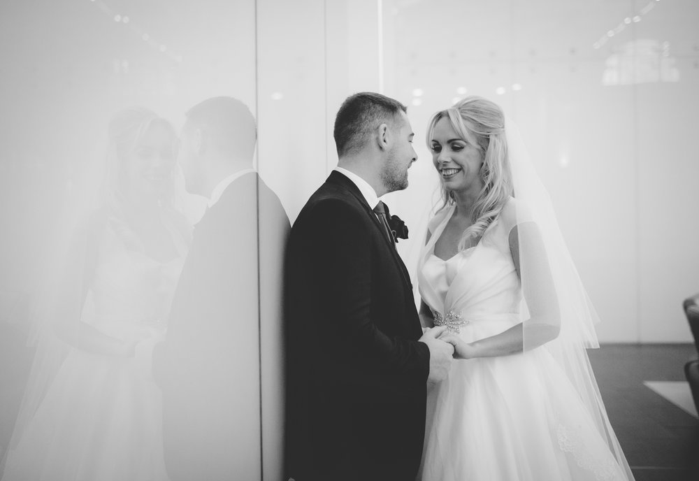 The bride and groom looking into one another eyes inside of the liver building- North west wedding photographer